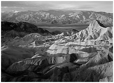 Badlands, Valley, and Telescope Peak from Zabriskie Point, winter sunrise. Death Valley National Park, California, USA. (black and white)