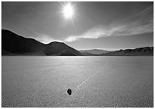 Sun and sliding rock on the Racetrack, mid-day. Death Valley National Park, California, USA. (black and white)