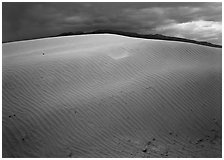 Dunes under rare stormy sky. Death Valley National Park, California, USA. (black and white)