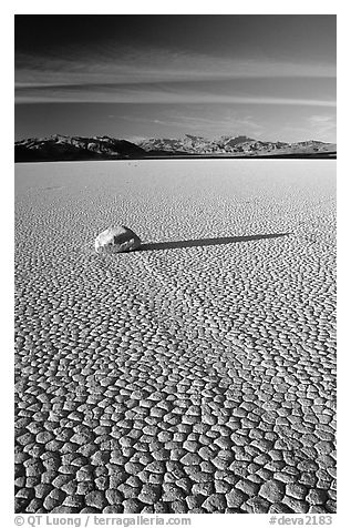 Tracks, sliding stone on the Racetrack playa, late afternoon. Death Valley National Park (black and white)