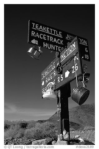 Tea kettle Junction sign, adorned with tea kettles. Death Valley National Park (black and white)