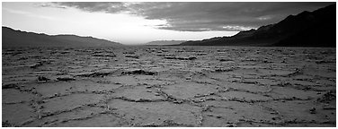 Hexagons on salt pan at sunrise. Death Valley National Park (Panoramic black and white)