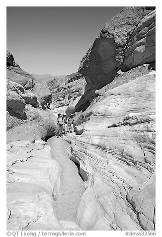 Hikers in narrows, Mosaic canyon. Death Valley National Park (black and white)