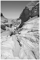 Hikers in narrows, Mosaic canyon. Death Valley National Park ( black and white)