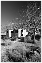 Cabin of Pete Aguereberry's mining camp in the Panamint Mountains, afternoon. Death Valley National Park, California, USA. (black and white)