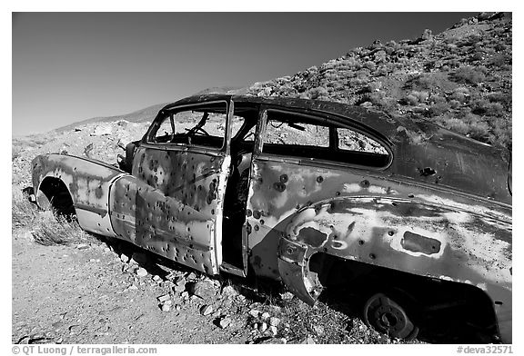 Car with bullet holes near Aguereberry camp, afternoon. Death Valley National Park (black and white)