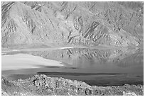 Rare seasonal lake on Death Valley floor and Black range, seen from above, late afternoon. Death Valley National Park, California, USA. (black and white)