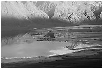 Reflections in Manly Lake at Badwater, seen from Aguereberry point, late afternoon. Death Valley National Park, California, USA. (black and white)