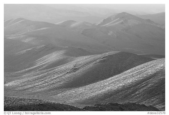 Tucki Mountains in haze of late afternoon. Death Valley National Park (black and white)