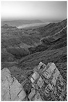 Rocks, canyon and Death Valley from Aguereberry point, sunset. Death Valley National Park, California, USA. (black and white)