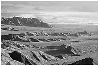 Eroded hills and salt pan from Aguereberry point, early morning. Death Valley National Park, California, USA. (black and white)