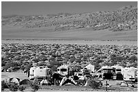 Campground and RVs at Furnace creek. Death Valley National Park, California, USA. (black and white)
