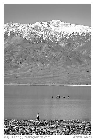 Tourist, ephemeral Loch Ness Monster in Manly Lake, and Telescope Peak. Death Valley National Park (black and white)