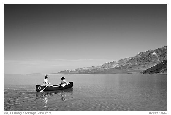 Canoeing on the ephemerald Manly Lake with Black Mountains in the background. Death Valley National Park (black and white)