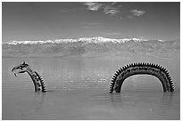 Loch Ness Monster art installation in Manly Lake and Panamint range. Death Valley National Park, California, USA. (black and white)