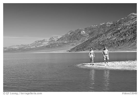 Couple on the shores of Manly Lake. Death Valley National Park (black and white)