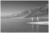Couple on the shores of Manly Lake. Death Valley National Park, California, USA. (black and white)