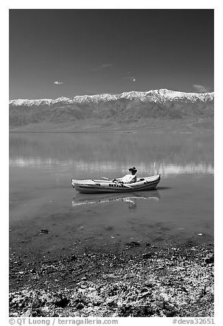 Salt formations, kayaker, and Panamint range. Death Valley National Park (black and white)
