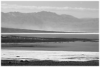 Salt Flats on Valley floor and Owlshead Mountains, early morning. Death Valley National Park, California, USA. (black and white)