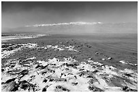 Salt formations and Manly Lake, morning. Death Valley National Park, California, USA. (black and white)