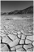 Mud cracks and Funeral mountains. Death Valley National Park ( black and white)