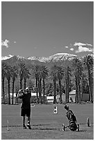 Golfer in Furnace Creek Golf course. Death Valley National Park, California, USA. (black and white)