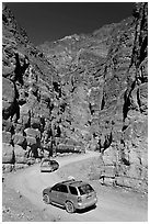 Cars in narrows, Titus Canyon. Death Valley National Park, California, USA. (black and white)