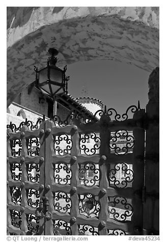 Gate, lamp, and arch, Scotty's Castle. Death Valley National Park (black and white)