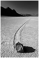 Sailing rock and travel groove on the Racetrack. Death Valley National Park, California, USA. (black and white)