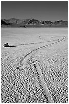 Zig-zagging track and sailing stone, the Racetrack playa. Death Valley National Park, California, USA. (black and white)