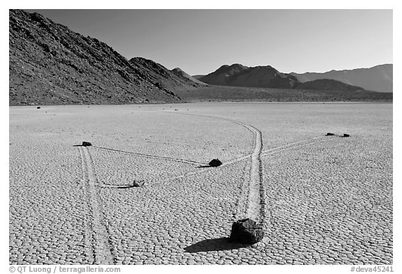 Moving rocks and non-linear tracks, the Racetrack. Death Valley National Park (black and white)