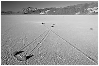 Sailing stones, the Racetrack playa. Death Valley National Park ( black and white)
