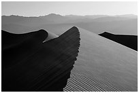 Dune ridges and Panamint Range. Death Valley National Park ( black and white)