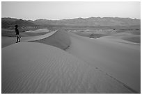 Park visitor looking, Mesquite Sand Dunes. Death Valley National Park ( black and white)