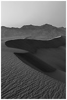 Sand dunes and Amargosa Range at dusk. Death Valley National Park ( black and white)