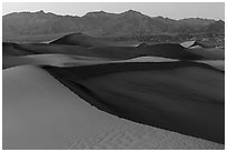 Mesquite Sand dunes and Amargosa Range at dusk. Death Valley National Park ( black and white)