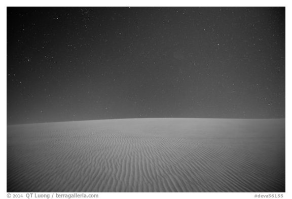 Dune ripples and starry sky. Death Valley National Park (black and white)