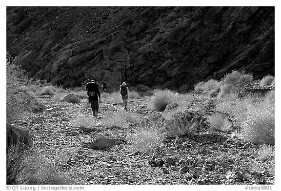 Hikers in a side canyon. Death Valley National Park (black and white)