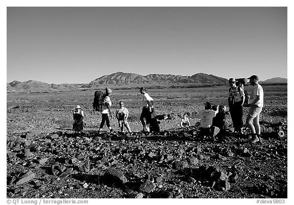 Backpackers on the Valley Floor. Death Valley National Park (black and white)