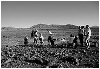 Backpackers on the Valley Floor. Death Valley National Park ( black and white)