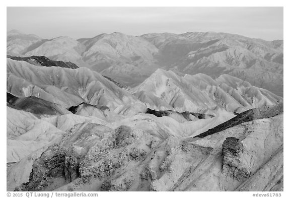 Badlands and mountains at sunrise, Twenty Mule Team Canyon. Death Valley National Park (black and white)