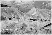 Badlands and mountain lighted by sunrise, Twenty Mule Team Canyon. Death Valley National Park ( black and white)