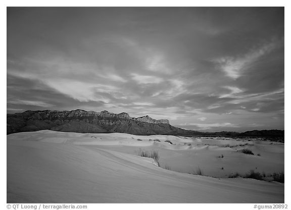 White sand dunes, Guadalupe range, and clouds at sunset. Guadalupe Mountains National Park (black and white)