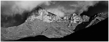 Cliffs and clouds illuminated by low sun. Guadalupe Mountains National Park (Panoramic black and white)