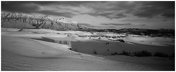Desert and mountain landscape with white sand dunes. Guadalupe Mountains National Park (Panoramic black and white)