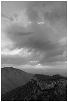 Dark clouds at sunrise over mountains. Guadalupe Mountains National Park ( black and white)