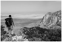 Hiker walking on Guadalupe Peak. Guadalupe Mountains National Park ( black and white)