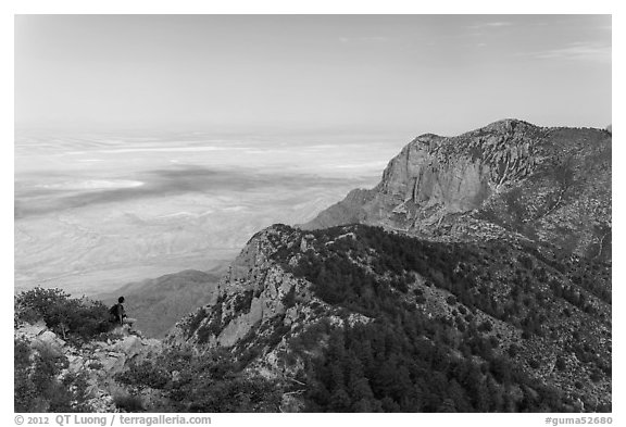 Hiker surveying view over mountains and plains. Guadalupe Mountains National Park (black and white)
