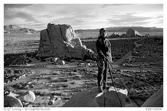 Climber getting ready to rappel down. Joshua Tree National Park (black and white)