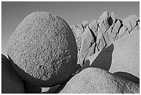 Round and triangular Boulders, Jumbo Rocks campground, sunset. Joshua Tree National Park, California, USA. (black and white)
